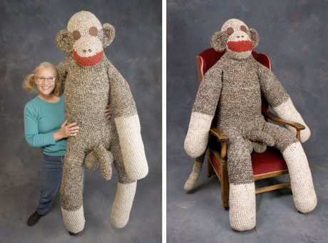 Huge sock monkey with a li