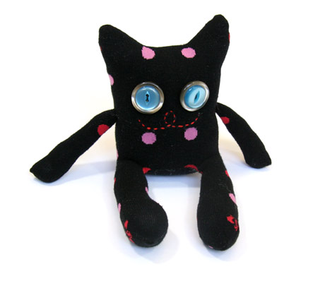 Black and spotty sock monster