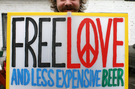 Free love and less expensive beer protest sign