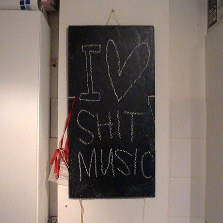 I Love shit music written on blackboard