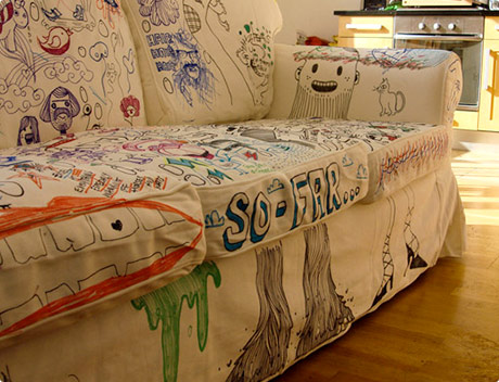 Doodles on white sofa