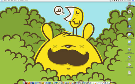 Screengrab of Mr. Moustache desktop which is a cartoon bear with a bird on it's head stood in some bushes